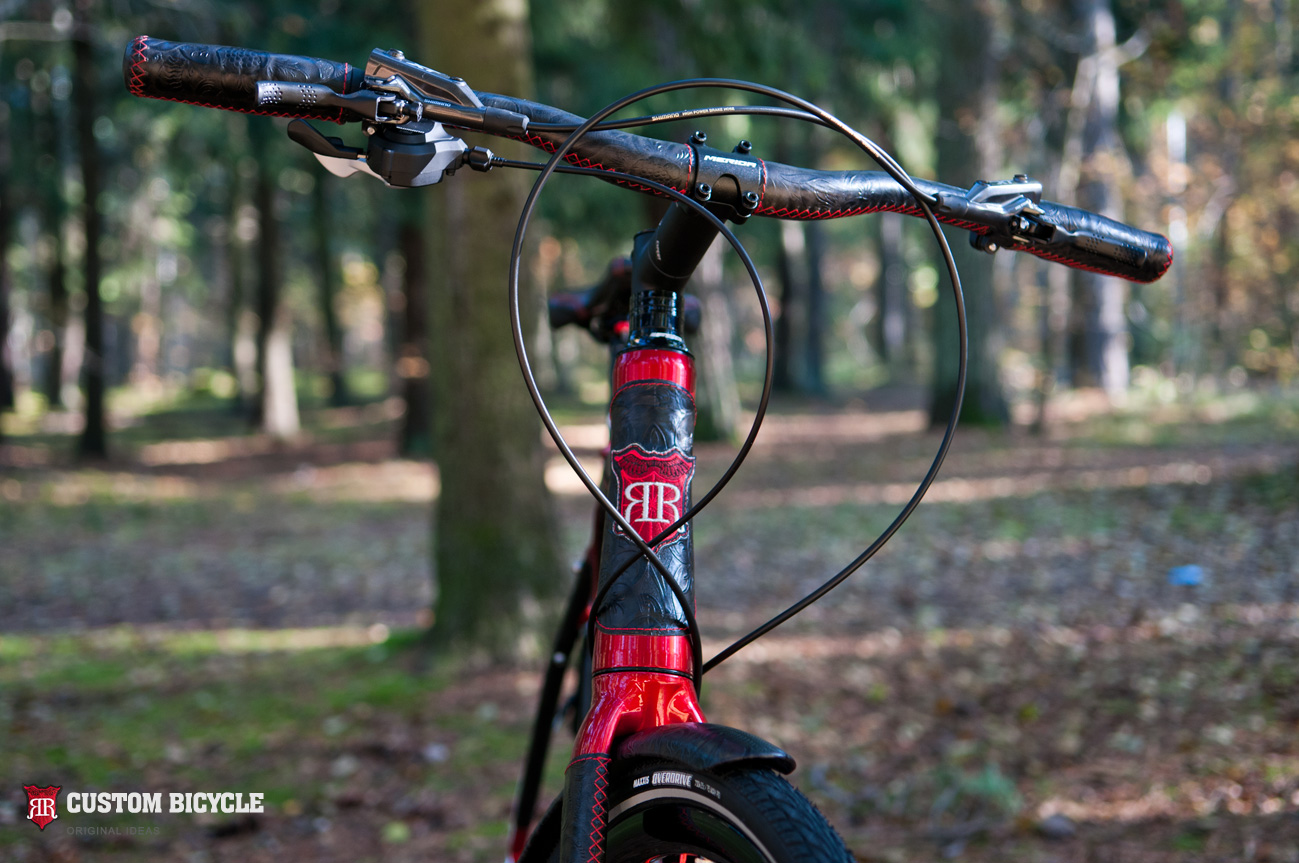 Handlebar – steel, handles - rubber, covered with a natural leather and red threads
